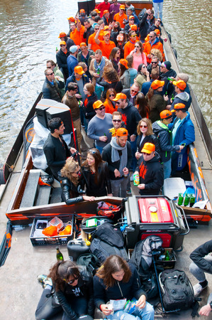 boat party: AMSTERDAM NETHERLANDS APRIL 27: Crowd of people on a boat party during King Day on April 27 2015 in Amsterdam. King Day is biggest festival celebrating the birth of Dutch royalty.