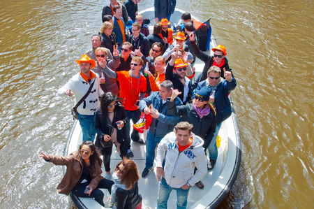 boat party: AMSTERDAM NETHERLANDS APRIL 27: Boat party during King Day on April 27 2015 in Amsterdam. Kings Day is biggest festival celebrating the birth of Dutch royalty.