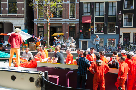 boat party: AMSTERDAM NETHERLANDS APRIL 27: Boat party on Amsterdam canal during King Day on April 27 2015 in Amsterdam. King Day is the largest openair festivity in Amsterdam. Editorial