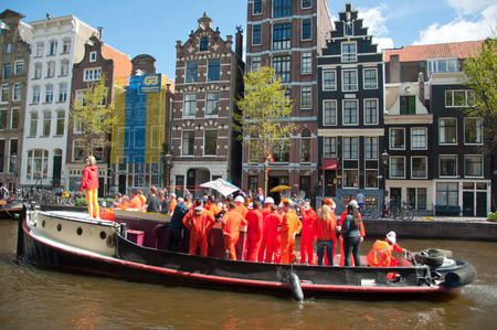 boat party: AMSTERDAM NETHERLANDS APRIL 27: Boat party with DJ on a boat Amsterdam canal during King Day on April 27 2015. King Day is the largest openair festivity in Amsterdam the Netherlands.
