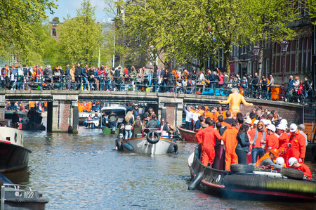 boat party: AMSTERDAM NETHERLANDS APRIL 27: Boat party through Amsterdam canals with unlimited beer during King Day on April 27 2015. King Day is the largest openair festivity in Amsterdam the Netherlands. Editorial
