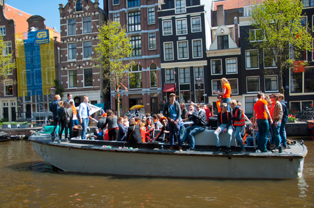 boat party: AMSTERDAM NETHERLANDS APRIL 27: Boat party along Amsterdam canals during King Day on April 27 2015 in Amsterdam. King Day is the largest openair festivity in Amsterdam the Netherlands.