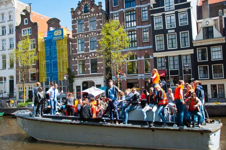 boat party: AMSTERDAM NETHERLANDS APRIL 27: Boat party along Amsterdam canals during King Day on April 27 2015 in Amsterdam.King Day is the largest openair festivity in Amsterdam the Netherlands. Editorial