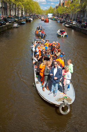 revellers: AMSTERDAM APRIL 27: People on Party Boat with unlimited beer soda and wine aboard on King39s Day on April 272015. King39s Day is the largest openair festivity in Amsterdam the Netherlands.