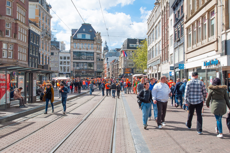 revellers: AMSTERDAM-APRIL 27: Crowd of people celebrate the Kings Day on Rokin street on April 27,2015. Koningsdag or Kings Day is a national holiday in the Kingdom of the Netherlands celebrated on 27 April.
