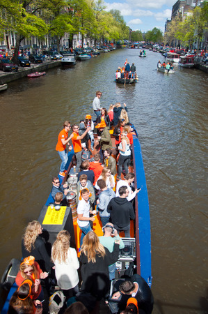 revellers: AMSTERDAM APRIL 27: People on Party Boat with unlimited beer soda and wine aboard celebrate King Day on April 27 2015. King Day is the largest openair festivity in Amsterdam. Editorial