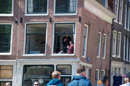 revellers: AMSTERDAM APRIL 27: People celebrate Kings Day in Amsterdam apartment on April 27 2015. King Day Koningsdag is held on 27 April the king birthday every year.