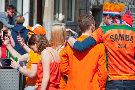 revellers: AMSTERDAM APRIL 27: Street party during King Day on April 27 2015 in Amsterdam the Netherlands. Kings Day is the biggest festival celebrating the birth of Dutch royalty.