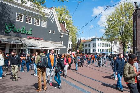 revellers: AMSTERDAM APRIL 27: Crowd of people during King Day on Amsterdam street on April 27 2015. King Day Koningsdag is held on 27 April the king birthday every year.