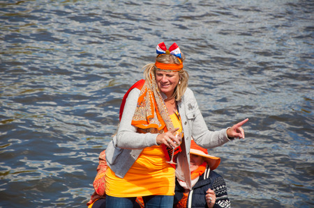 boat party: AMSTERDAM APRIL 27: Active participant on boat party during King Day on April 27 2015 in Amsterdam the Netherlands. Kings Day is the biggest festival celebrating the birth of Dutch royalty.