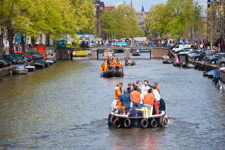 revellers: AMSTERDAM APRIL 27: People on Party Boat with unlimited beer soda and wine aboard on King Day on April 27 2015. King Day is the largest openair festivity in Amsterdam.
