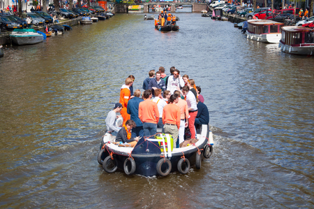 boat party: AMSTERDAM NETHERLANDS APRIL 27: Boat party along Amsterdam canals during King Day on April 27 2015. King Day is the largest openair festivity in Amsterdam the Netherlands.