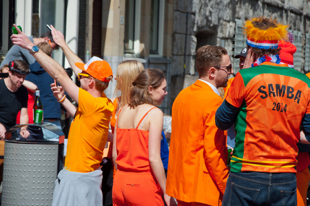 revellers: AMSTERDAM APRIL 27: Open air party during King Day on April 27 2015 in Amsterdam the Netherlands. Kings Day is the biggest festival celebrating the birth of Dutch royalty.