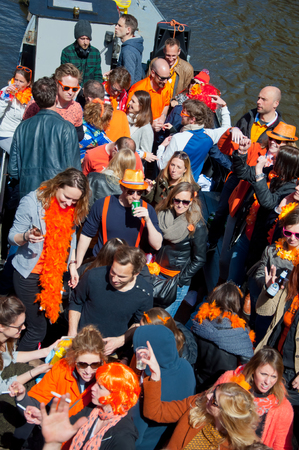 revellers: AMSTERDAM NETHERLANDS APRIL 27: People on Party Boat celebrate King Day on April 27 2015 the Netherlands. King Day is the largest openair festivity in Amsterdam. Editorial