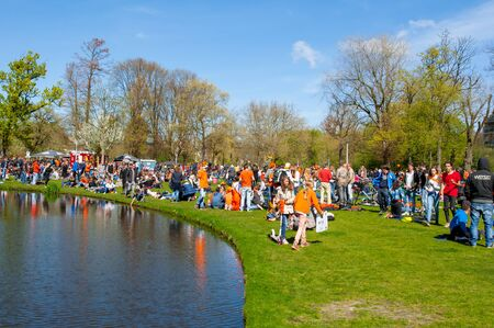 revellers: AMSTERDAM-APRIL 27: People in Vondelpark during Kings Day on April 27,2015.Kings Day is the largest open-air festivity in Amsterdam, the Netherlands.