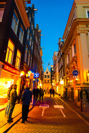red light district: AMSTERDAM-APRIL 27: Nightlife on Amsterdam narrow street in red light district on April 27,2015, the Netherlands.