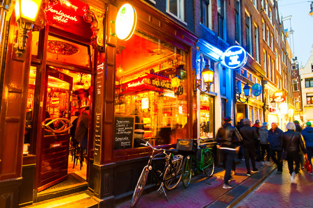 red light district: AMSTERDAM-APRIL 27: Nightlife on Amsterdam narrow street around red light district on April 27,2015, the Netherlands.