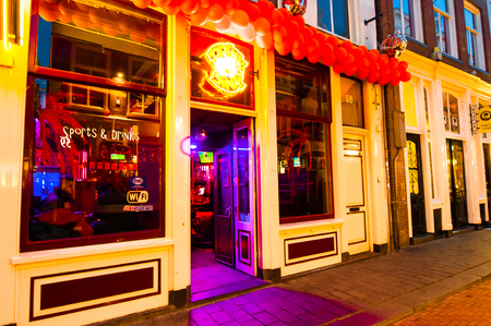 red light district: AMSTERDAM-APRIL 27: Local restaurant in red light district invites guests to have dinner on April 27,2015, the Netherlands.
