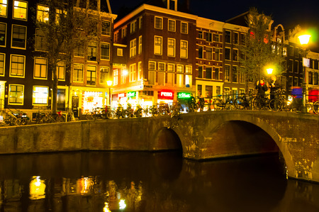 red light district: AMSTERDAM-APRIL 29: Red light district at night on April 29, 2015 in Amsterdam, the Netherlands. The red-light district is a part of city, where prostitution is legal.