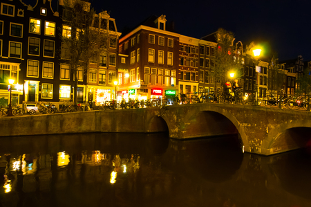 red light district: AMSTERDAM-APRIL 29: Red light district at night on April 29, 2015. The red-light district is a part of city, where prostitution is legal.