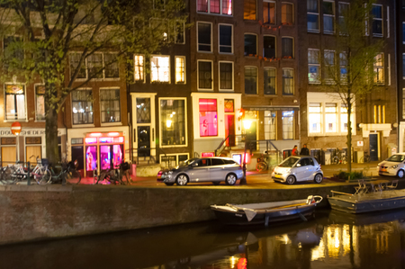 red light district: AMSTERDAM-APRIL 29: Red light district at night on April 29, 2015. The red-light district is a part of city, where prostitution is concentrated. Editorial