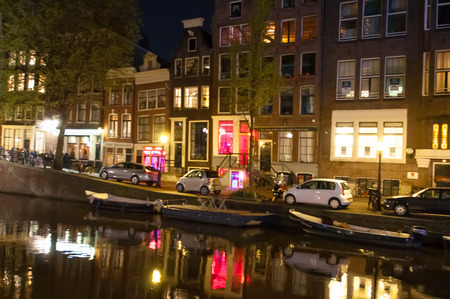 red light district: AMSTERDAM-APRIL 29: Red light district at night on April 29, 2015. The red-light district is a part of city, there is a concentration of prostitution and sex-oriented businesses. Editorial