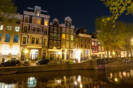 red light district: AMSTERDAM-APRIL 29: Red light district at night on April 29, 2015. The red-light district is a part of an urban area where there is a concentration of prostitution and sex-oriented businesses. Editorial