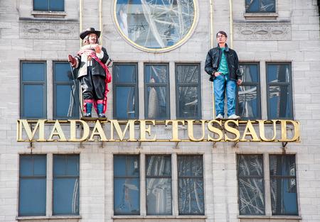 dam square: AMSTERDAM-APRIL 30: Madame Tussauds museum on Dam Square on April 30,2015 in Amsterdam. Madame Tussauds is a wax museum located on Dam Square in Amsterdam, the Netherlands.