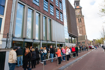 anne: AMSTERDAM-APRIL 30: People queue up to the Anne Frank House Museum on April 30,2015.The Anne Frank House Museum is one of Amsterdams most popular and important museums opened in 1960. Editorial