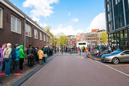 anne: AMSTERDAM-APRIL 30: Ticket-queue to the Anne Frank House Museum on April 30,2015.The Anne Frank House Museum is one of Amsterdams most popular and important museums opened in 1960.