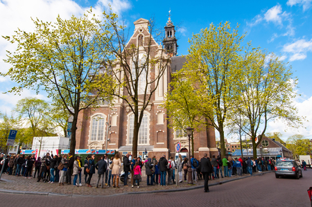 frank: AMSTERDAM-APRIL 30: People stand in a queue to visit the Anne Frank House Museum on April 30,2015.The Anne Frank House Museum is one of Amsterdams most popular and important museums opened in 1960. Editorial