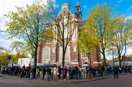 dutch girl: AMSTERDAM-APRIL 30: People stand in a queue to the Anne Frank House Museum on April 30,2015.The Anne Frank House Museum is one of Amsterdams most popular and important museums opened in 1960. Editorial