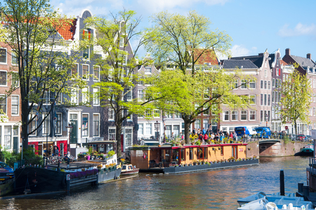 prinsengracht: AMSTERDAM-APRIL 30: The Prinsengracht canal with houseboats on April 30,2015. Prinsengracht is the third and outermost of the three main canals: Herengracht, Prinsengracht, and Keizersgracht. Editorial