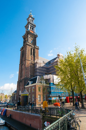 westerkerk: AMSTERDAM-APRIL 30: The belfry of the Westerkerk from the Prinsengracht canal on April 30,2015, the Netherlands. Westerkerk is a Dutch Protestant church located on the Prinsengracht canal. Editorial