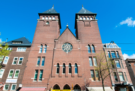 fatih: AMSTERDAM-APRIL 30: Front view of Amsterdam Fatih Mosque on April 30,2015, the Netherlands. The mosque is located in a former Catholic church in Jordaan district. Editorial