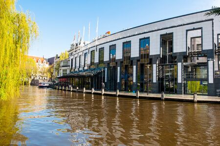 brasserie: AMSTERDAM-APRIL 30: Holland Casino as seen from the Singelgrachtkering Canal on April 30,2015, the Netherlands. The casino features 700 slot machines, 55 table games, 3 bars, and a brasserie. Editorial