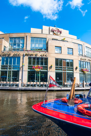 hard rock cafe: AMSTERDAM-APRIL 30: Hard Rock Cafe on the Singelgrachtkering Canal with boat on April 30,2015. Hard Rock Cafe Amsterdam offers an immersive experience in the waterside restaurant and cocktail bar.