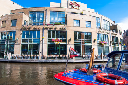 hard rock cafe: AMSTERDAM-APRIL 30: Famous Hard Rock Cafe on the Singelgrachtkering Canal on April 30,2015. Hard Rock Cafe Amsterdam offers an immersive experience in the waterside restaurant and cocktail bar.