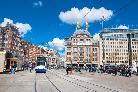 flagship: AMSTERDAM-APRIL 30: Dam Square with De Bijenkorf flagship store on the background on April 30, 2015 in Amsterdam, Netherlands. Editorial