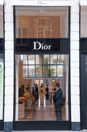luxury goods: AMSTERDAM-APRIL 30: Dior store in the expensive and posh P.C.Hooftstraat shopping street on April 30,2015 in Amsterdam. The French luxury goods company was founded 16 December 1946 by Christian Dior.