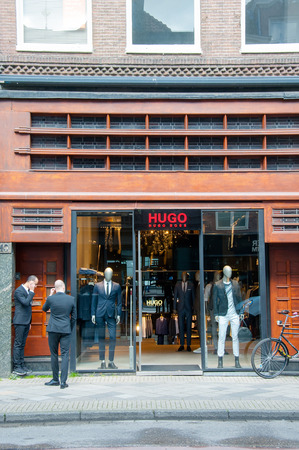 hugo: AMSTERDAM-APRIL 30: Hugo Boss store on the P.C.Hooftstraat shopping street on April 30,2015 the Netherlands. The German luxury fashion and style house was founded in 1924 by Hugo Boss.