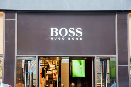 hugo: AMSTERDAM-APRIL 30: Hugo Boss signboard on the P.C.Hooftstraat shopping street on April 30,2015 the Netherlands. The German luxury fashion and style house was founded in 1924 by Hugo Boss.