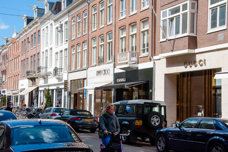 chanel: AMSTERDAM-APRIL 30: The PCHooftstraat fashion street with the row of worlds biggest brands on April 30, 2015. PCHooftstraat is a small street in a close neighborhood of the Rijksmuseum. Editorial