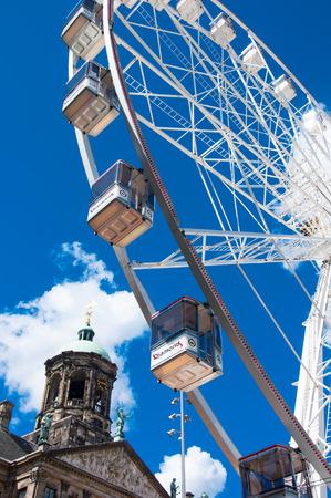 dam square: AMSTERDAM,NETHERLANDS-APRIL 30: Ferris wheel on Dam Square on April 30,2015 in Amsterdam.