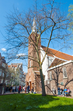 english famous: Amsterdam, Netherlands-April 30: The English Reformed Church at famous Begijnhof, tourists go sightseeing on April 30,2015. The Begijnhof is one of the oldest inner courts in the heart of Amsterdam.