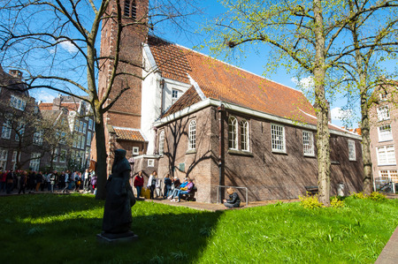 english famous: Amsterdam, Netherlands-April 30: The English Reformed Church at famous Begijnhof, tourists go sightseeing on April 30,2015. The Begijnhof is one of the oldest inner courts in the city of Amsterdam.