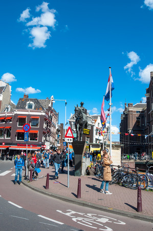 wilhelmina: Amsterdam, Netherlands-April 30: Monument of Queen Wilhelmina, crowd of people and tourists on the street on April 30,2015. Wilhelmina was Queen of the Kingdom of the Netherlands from 1890 to 1948.