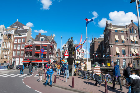 wilhelmina: Amsterdam, Netherlands-April 30: Statue of Queen Wilhelmina, crowd of people and tourists on the street on April 30,2015. Wilhelmina was Queen of the Kingdom of the Netherlands from 1890 to 1948. Editorial