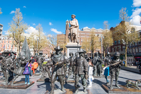 rembrandt: Amsterdam-April 30: Rembrandtplein (Rembrandt Square) with a bronze-cast representation The Night Watch, by Russian artists Mikhail Dronov and Alexander Taratynov on April 30, 2015, the Netherlands.