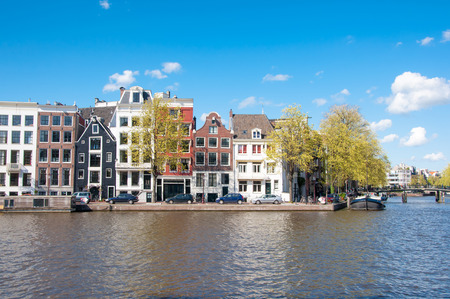 hotel building: Amsterdam cityscape in early spring during sunny day. The Netherlands.